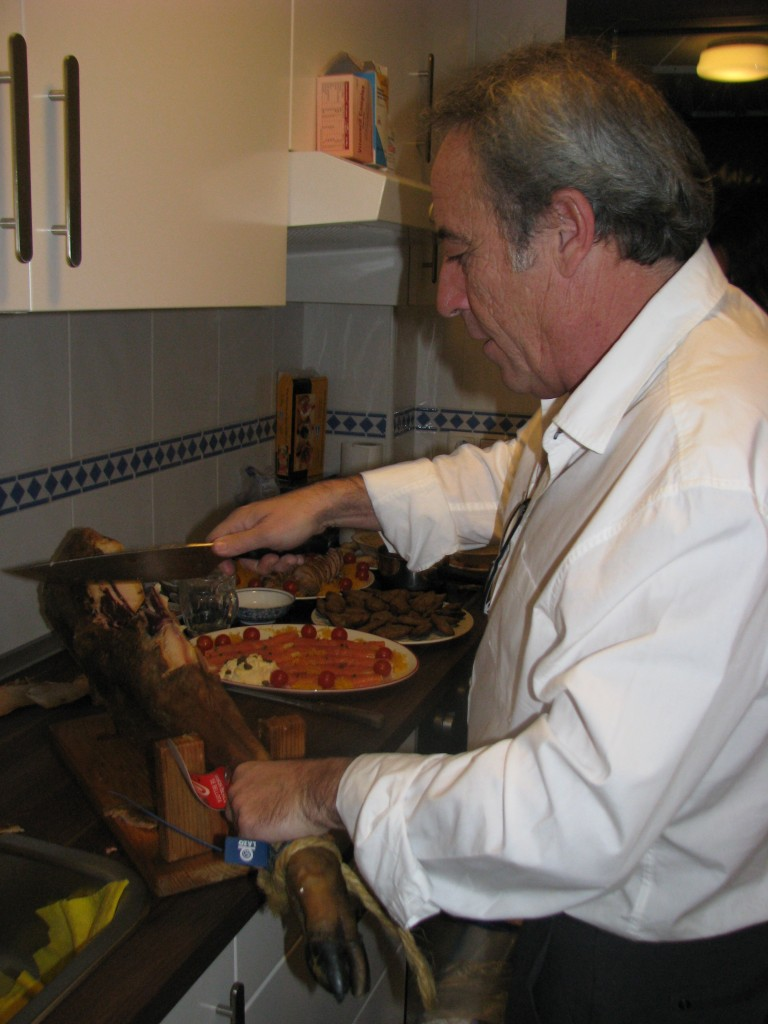 My friend, Antonio, carving the Iberian ham--a meat Andres's family have on their Christmas table.